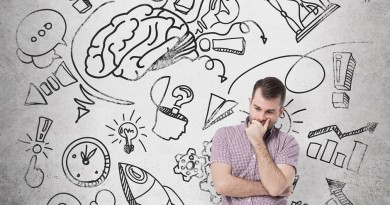 A handsome young man in casual clothes is thinking about business development. A brainstorm sketch is drawn on the concrete wall.