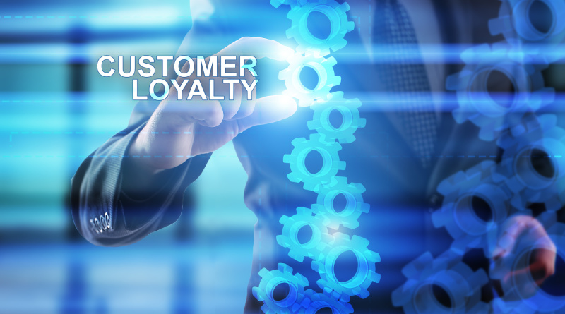 """Businessman is selecting """"Customer loyalty"""" on the virtual screen."""
