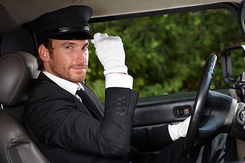 Confident chauffeur in elegant automobile