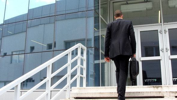 Businessman Entering Corporate Building preview image